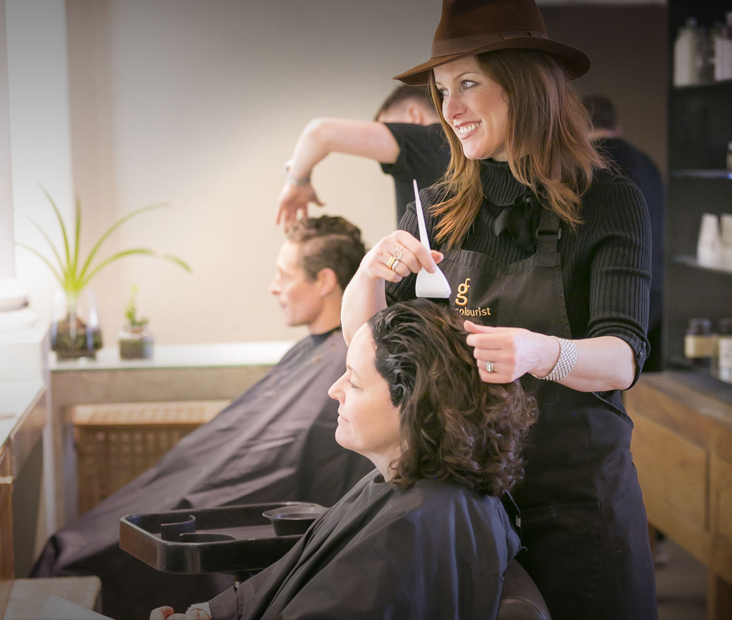 Gina Conway in her salon with a client